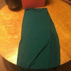 Teal skirt with slit.